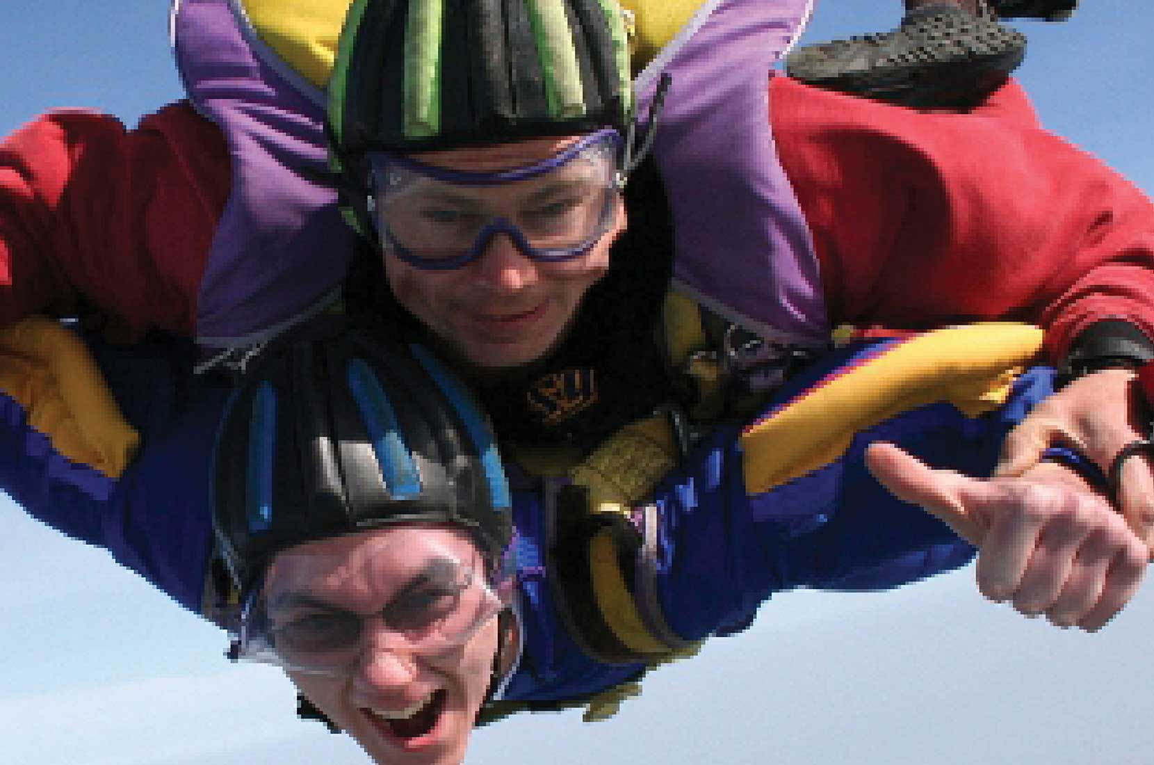 Dystonia Society two people taking part in a tandem skydive – Brand+Soul – Brand Strategy | Logo & Identity Design | Brochure Catalogue & Direct Mail | Marketing | Web & Digital