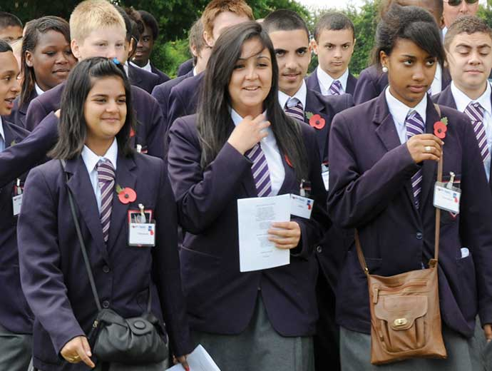 Remembrance Travel –group of school children wearing poppies